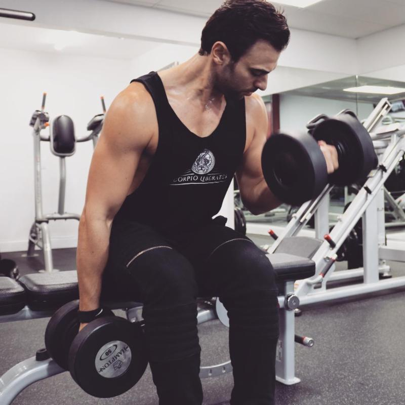 Federico lifts our Hampton Gel-Grip Urethane dumbbells.
