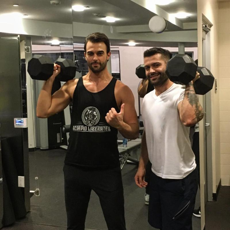 "Federico and a client show off their ""gains."""