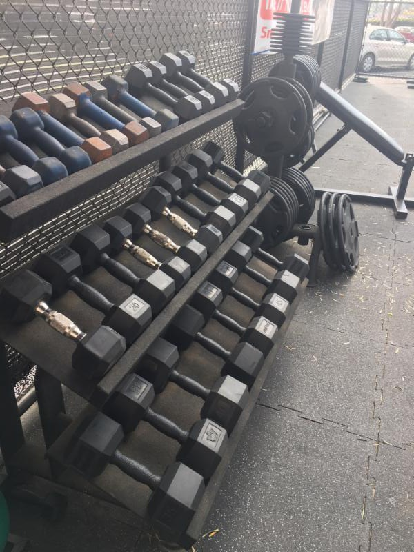 Hampton Durabell dumbbells on a three-tiered flat rack.